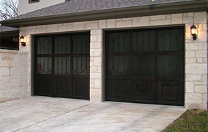fix garage doors spring